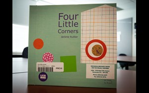 A close up of the cover of Four Little Corners